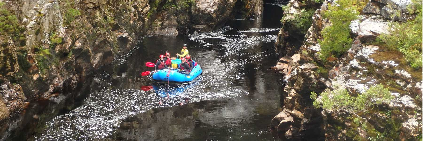 Raft drifting through the Irenabyss on the Franklin River