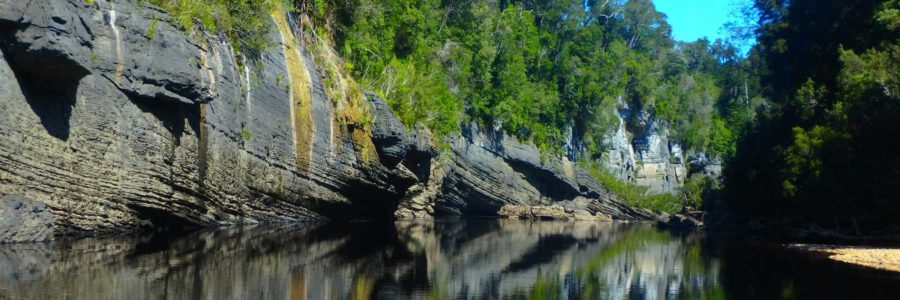 Reflections of limestone cliffs along the Lower Franklin River, Tasmania